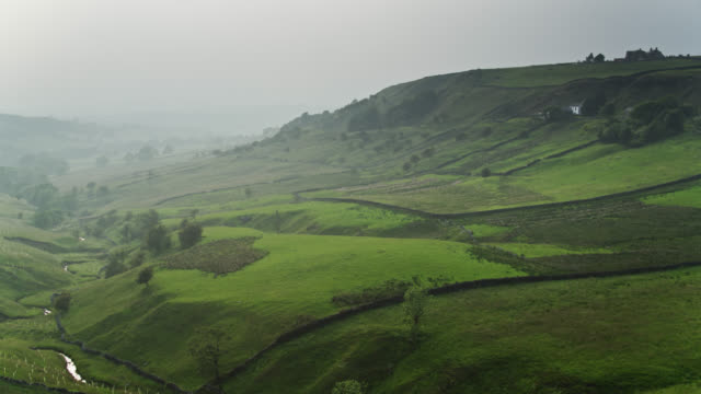 hazy day in pendle, lancashire - aerial - lancashire stock videos & royalty-free footage
