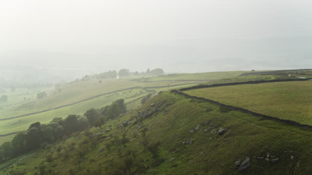 hazy evening in the pennines - drone shot - lancashire stock videos & royalty-free footage
