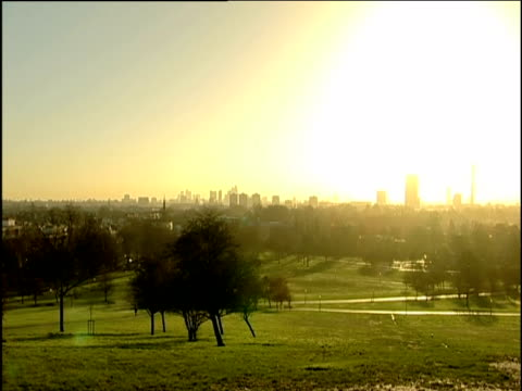 Hazy London skyline from Primrose Hill in early morning