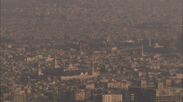 A hazy long shot of the Umayyad Mosque and the surrounding buildings of Damascus. Available in HD.