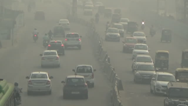 hazy new delhi by air pollution, india - air pollution stock videos & royalty-free footage