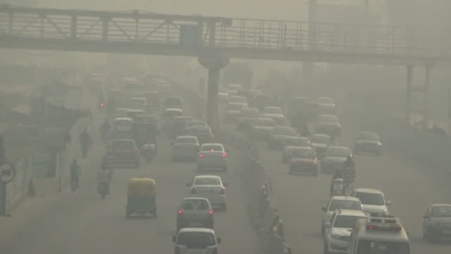 hazy new delhi by air pollution, india - smog video stock e b–roll