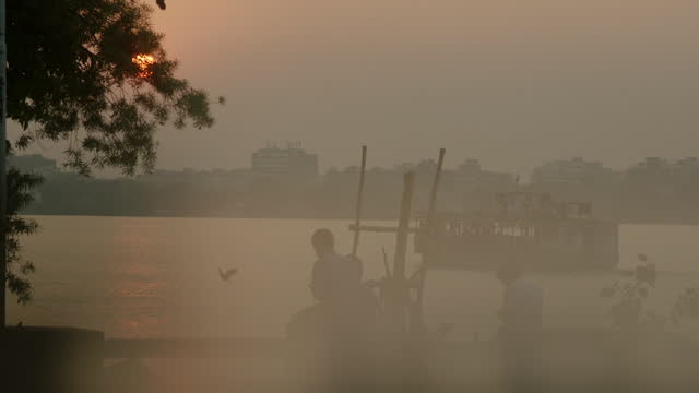 hazy shots of river at sunset, india - kolkata stock videos & royalty-free footage
