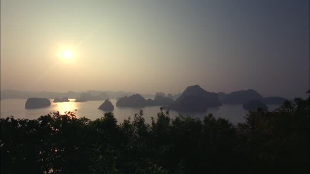 Hazy sunlight glows above the Vietnam jungle.