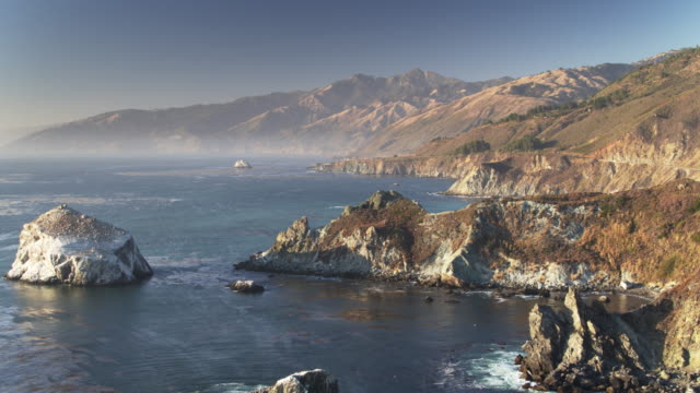 hazy sunset in big sur - drone shot - monterey county stock videos and b-roll footage