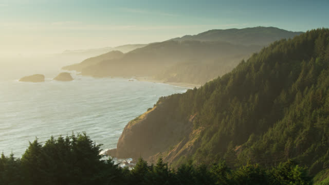 hazy sunset on the oregon coast - drone shot - oregon coast stock videos & royalty-free footage