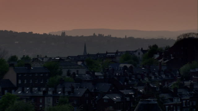 hazy sunset over streets of houses, newcastle. available in hd. - newcastle upon tyne stock-videos und b-roll-filmmaterial