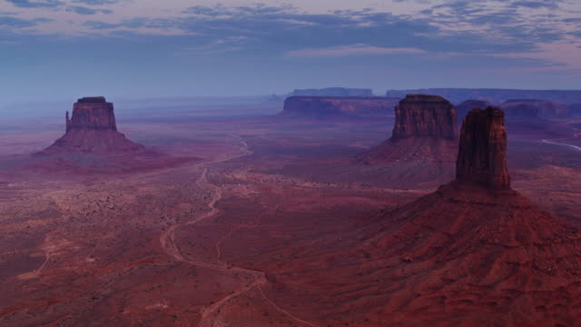 hazy twilight in monument valley - drone shot - navajo reservation stock videos and b-roll footage
