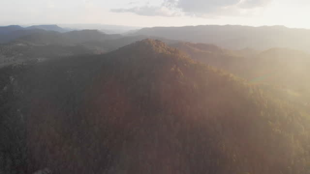 hazy view of a mountain range at dusk in the sierra madre mountains in the tarahumara region of the copper canyon area of the mexican state of chihuahua - chihuahua stock videos & royalty-free footage