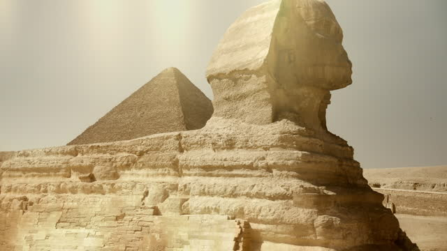 hazy views of pyramids and sphinx at giza, egypt - soft focus stock videos & royalty-free footage