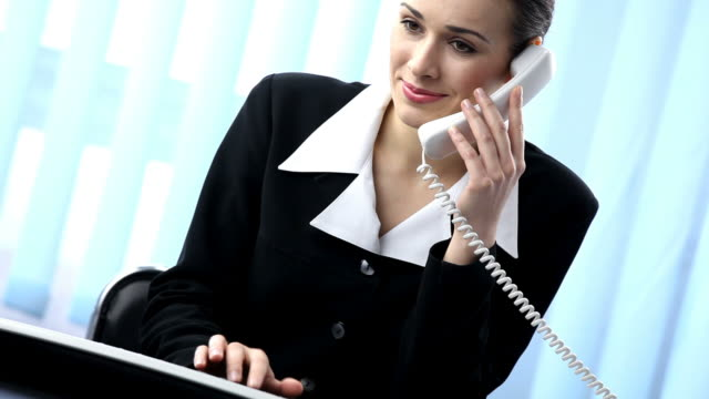 HD1080p30: Businesswoman working with computer and phone, tripod