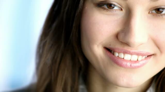 HD1080p30: Young happy woman smiling, flirting, looking at camera, tripod