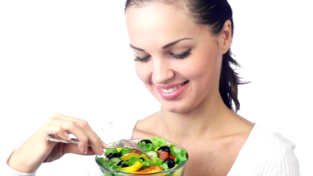 hd1080p30:: young woman with bowl of vegetarian salad on white - salad stock videos & royalty-free footage
