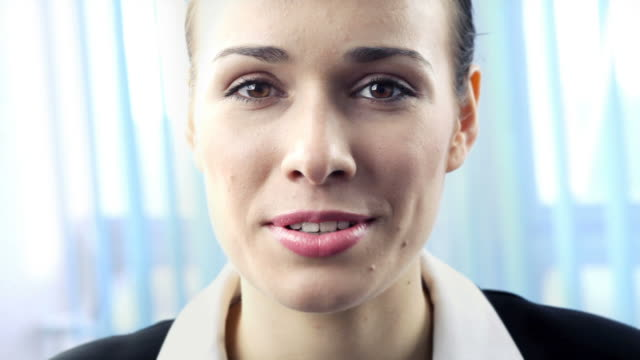 HD1080p30:Happy businesswoman smiling, speaking, looking at camera, tripod