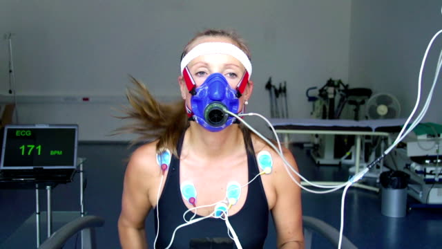 hd:athlete performing ecg and vo2 test on treadmill - test drive stock videos & royalty-free footage