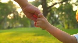 HD:Baby boy holding mother hand and running in the park.
