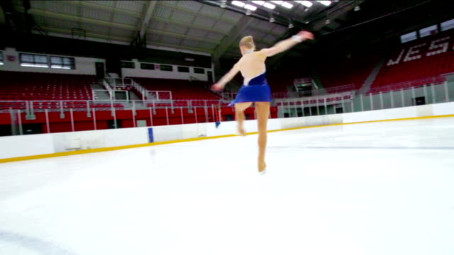 hd:beautiful female figure skater performing pirouette - ice skating stock videos and b-roll footage
