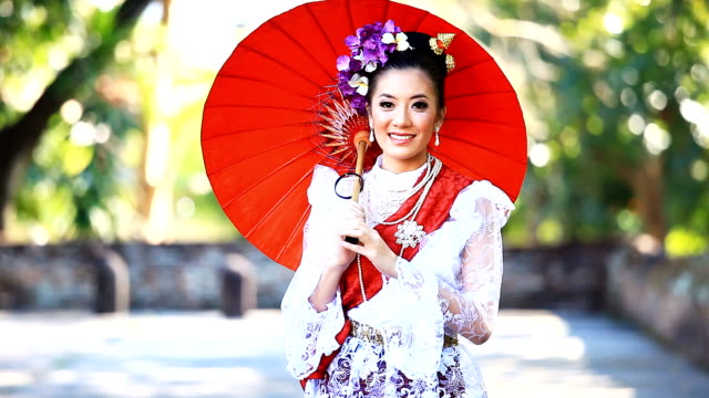 hd:beautiful thai women with smiley face. - umbrella stock videos and b-roll footage