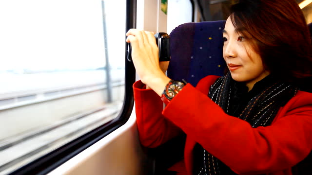 hd:beauty asian women taking outside view on the train. - vehicle seat stock videos & royalty-free footage