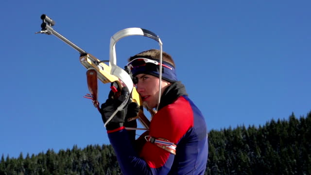 hd:biathlon competitor shooting during competition - biathlon stock videos and b-roll footage