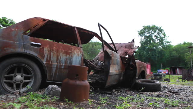 hd:body of the burnt car in the street. - weathered stock videos & royalty-free footage