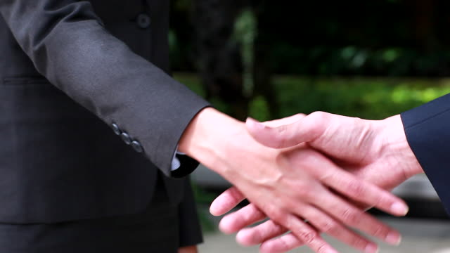 hd:business handshake. - dressing up stock videos & royalty-free footage