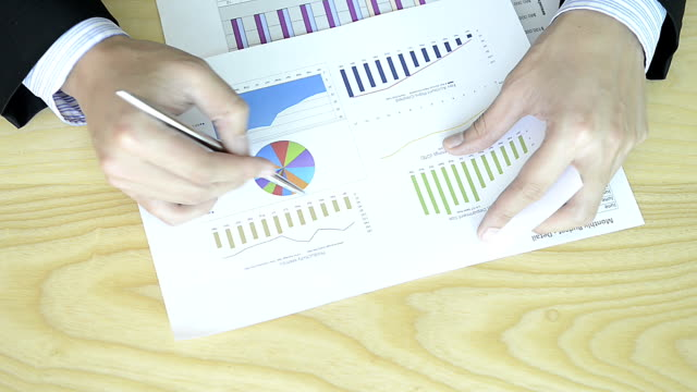 hd:businessman working with chart - bar graph stock videos and b-roll footage