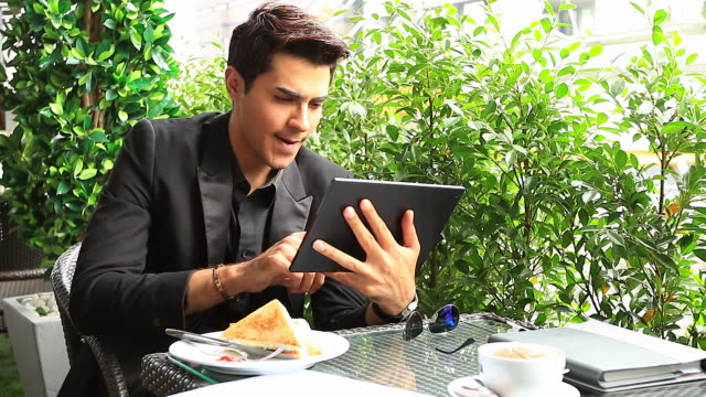 HD:Businessman working with tablet at coffee shop.
