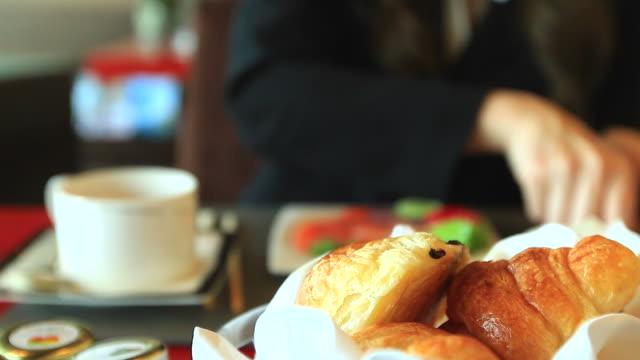 HD:Businesswoman eating breakfast at restaurant.