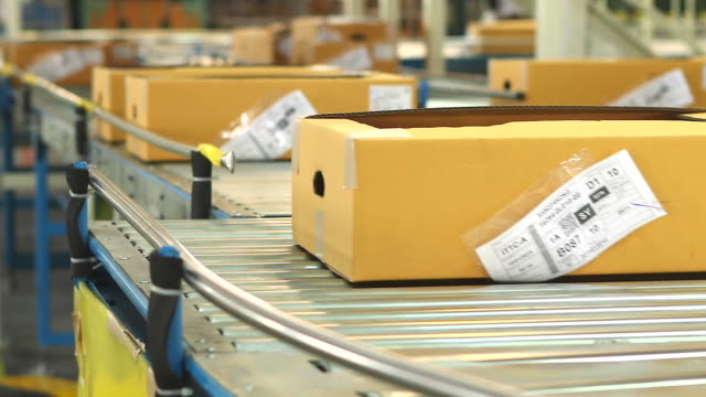 hd:carton box moving on conveyor rollers. - belt stock videos & royalty-free footage