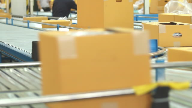 hd:carton box moving on conveyor rollers. - packet stock videos and b-roll footage