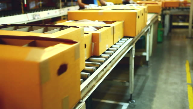 hd:carton box moving on conveyor rollers. - carton stock videos & royalty-free footage