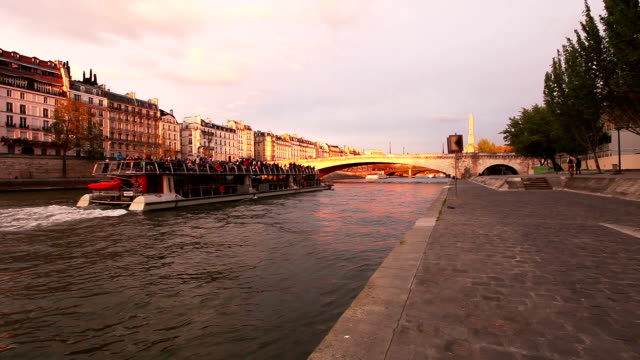 hd:central paris at sunset - river seine stock videos & royalty-free footage