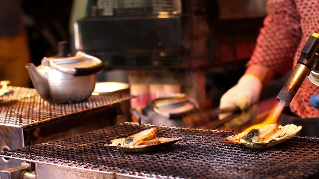 HD:Chef cooking japanese grilled hotate (scallop).