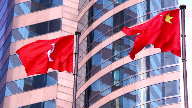 hd:china and hong kong flags. - politics stock videos & royalty-free footage