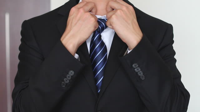 hd:closeup of businessman in black suit correcting a sleeve. - sleeve stock videos & royalty-free footage