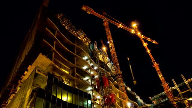 hd :工事現場から夜のタイムラプス撮影 - 建物の骨組み点の映像素材/bロール