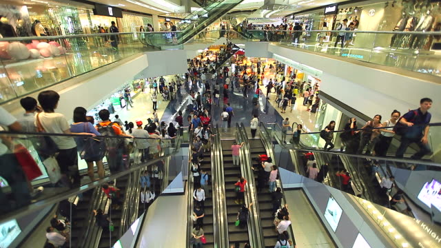 HD:Crowed people moving on escalator in shopping mall.