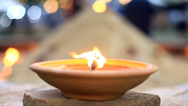 HD:fire in oil bowl.