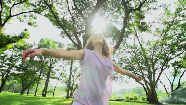 HD:Freedom happy woman feeling alive and free in nature breathing fresh air.
