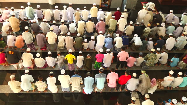 hd:group of islamic during prayer. - british culture stock videos & royalty-free footage
