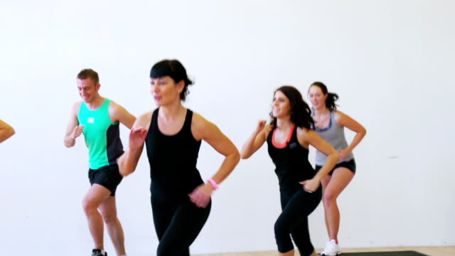 hd:group of young adult people doing aerobics - step aerobics stock videos and b-roll footage