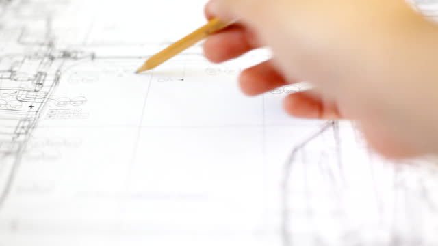 stockvideo's en b-roll-footage met hd:hand checking drawing work. - ingenieurswerk