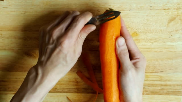 hd:hand peeling carrot - carrot stock videos & royalty-free footage