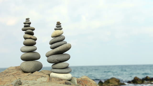 hd:hierarchy and balance - pebble stock videos & royalty-free footage