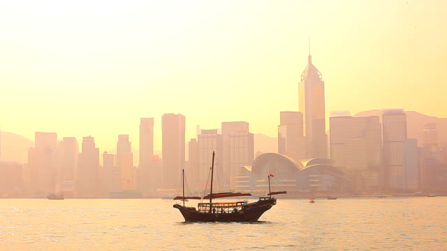 HD:Hong kong traditional sailing junk silhouette scene.