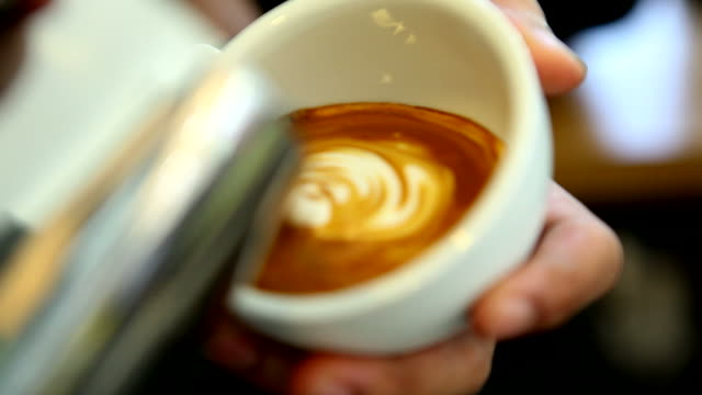 hd:latte art,milk pouring by a barista. - italian culture stock videos & royalty-free footage