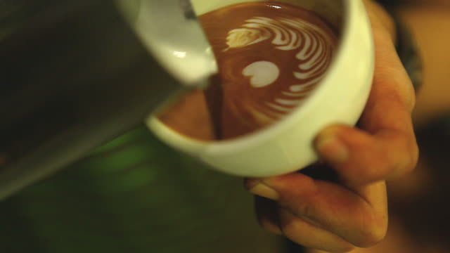 hd:latte art,milk pouring by a barista. - hot chocolate stock videos and b-roll footage