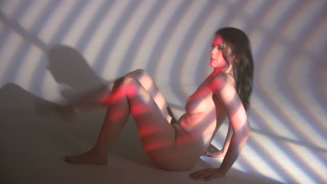 hd:light beams on naked woman moves legs, stomach - human reproductive organ stock videos & royalty-free footage