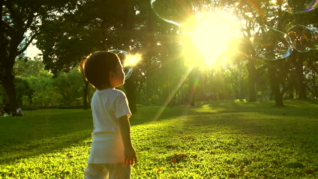 hd:little boy in the sunset catches soap bubbles. - bubble stock videos & royalty-free footage